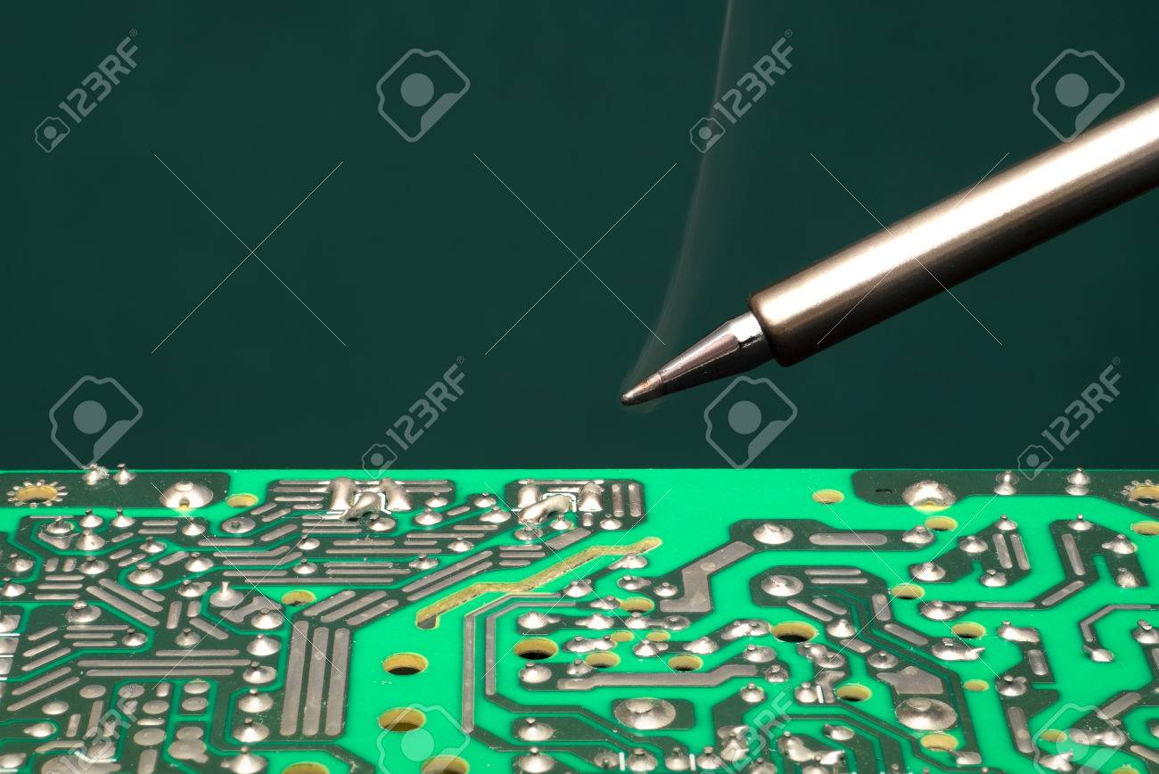 Solder Circuit Board Stock Photos Royalty Free Wiring 11796d12469976383wayswitchdiagramschematic3way6lightsjpg The Warmed Soldering Iron Over Electronic Rh 123rf Com