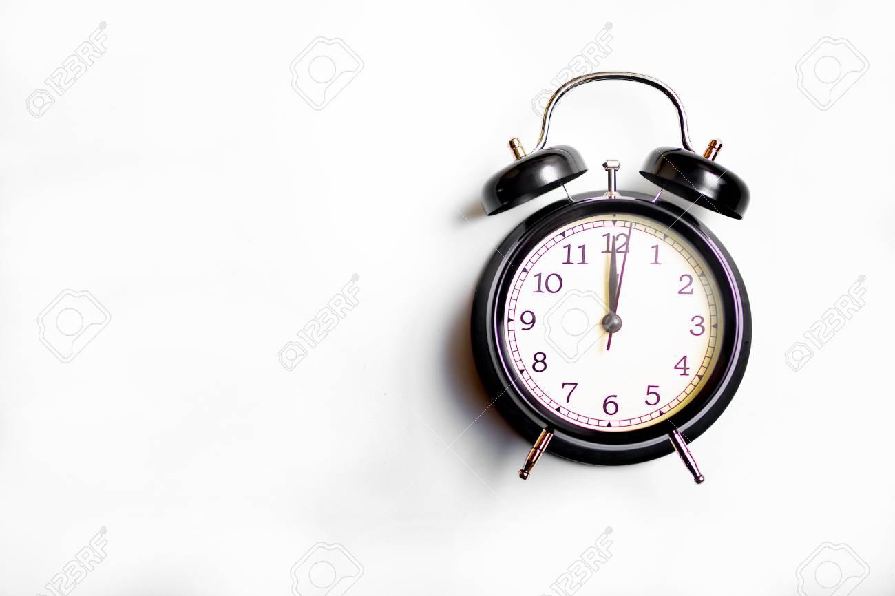 Black alarm clock on white background. Concept time. - 111990601