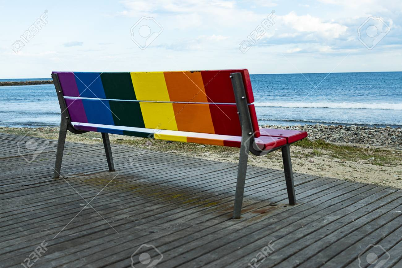 Wondrous Rainbow Lgbt Pride Flag Painted On A Wooden Bench On The Beach Pdpeps Interior Chair Design Pdpepsorg