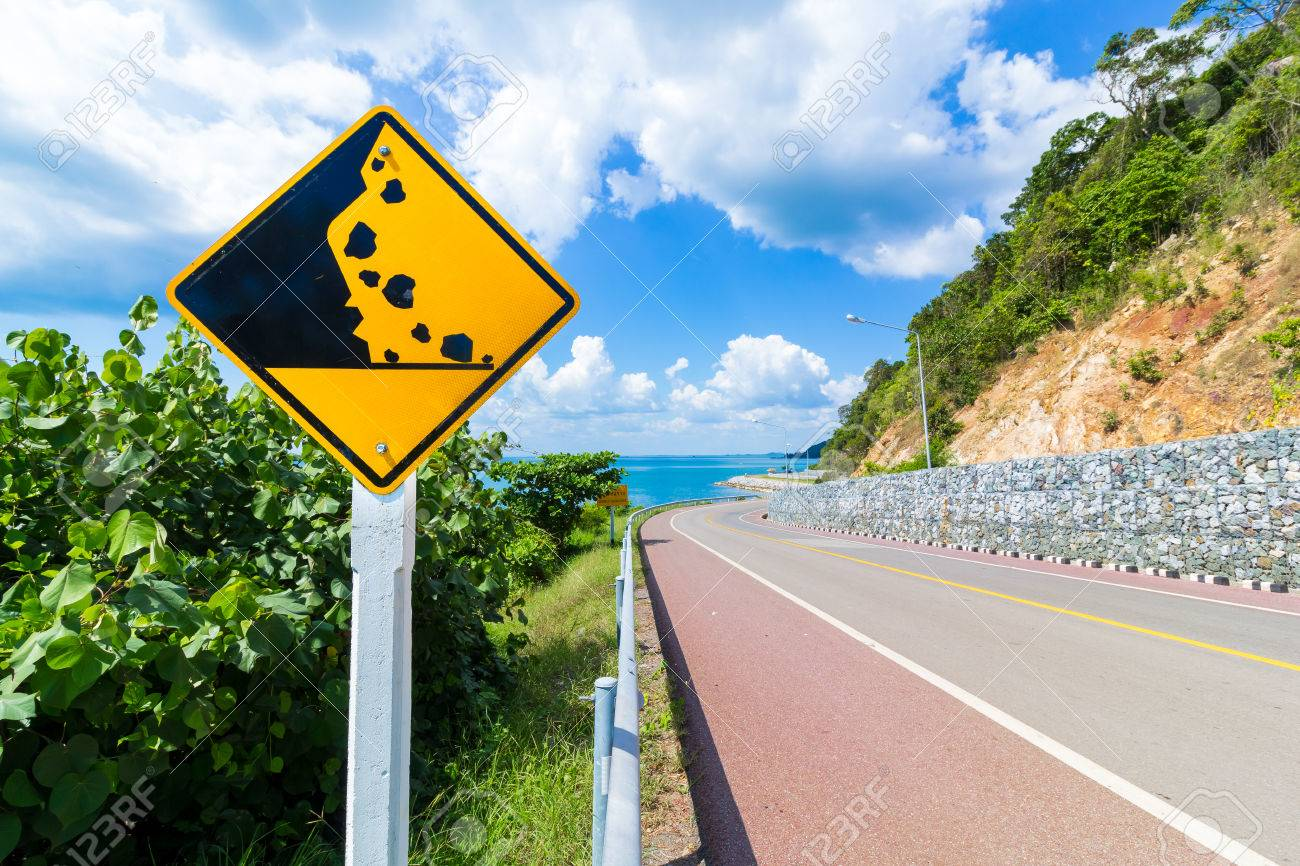 Beware of falling rock sign in Thailand road - 50654605