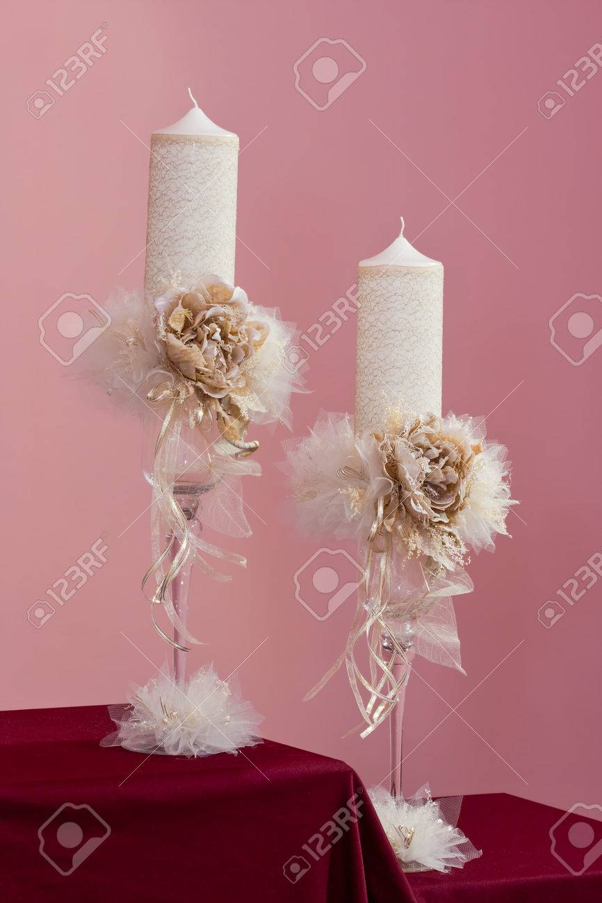Couple Of White And Gold Bridal Candles With Artificial Flowers