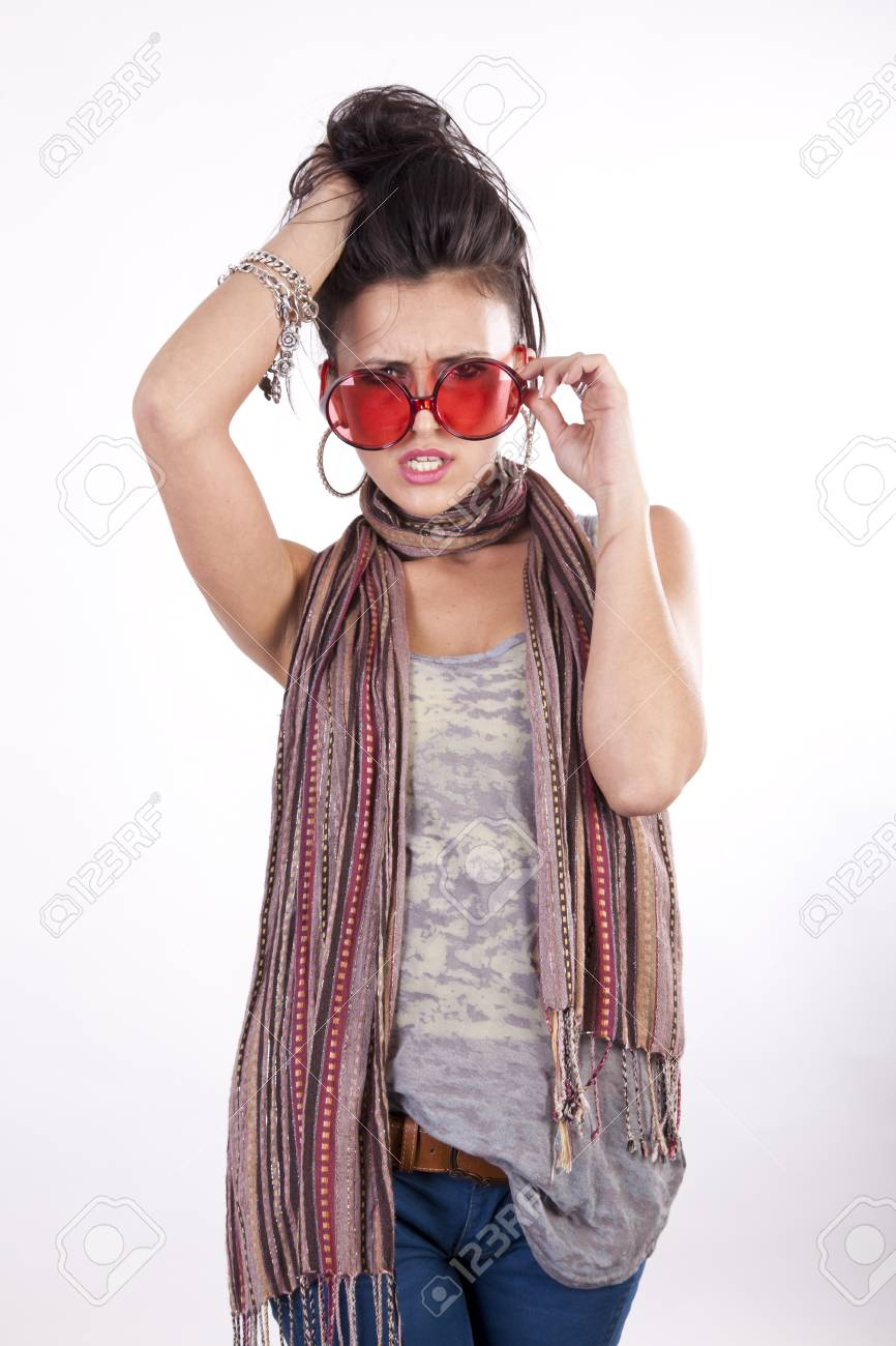 Young beautiful angry girl wearing funny red sunglasses. Stock Photo - 13757378