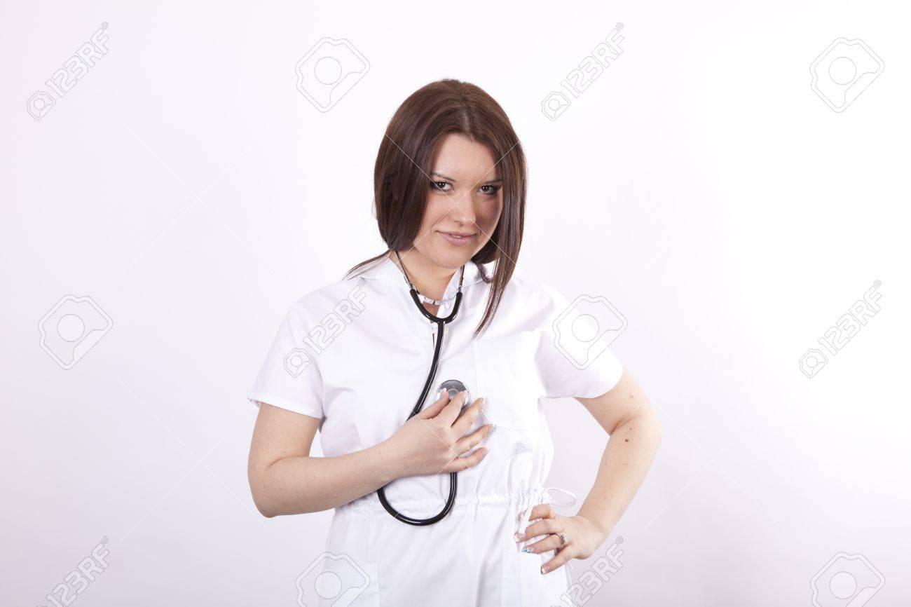 Young beautiful female doctor holding stethoscope Stock Photo - 13827476