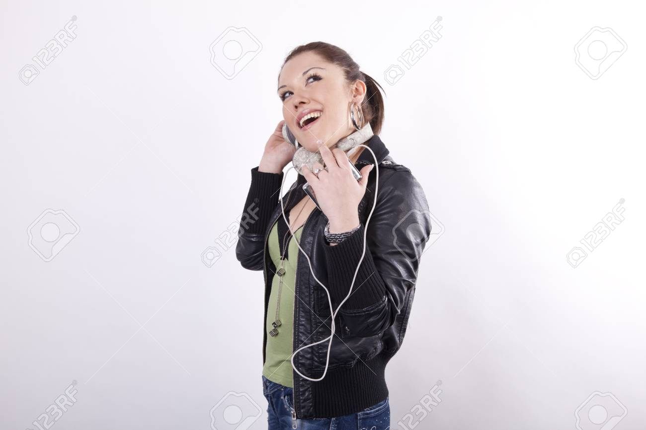 Young beautiful woman listening music and smiling. Stock Photo - 13828903