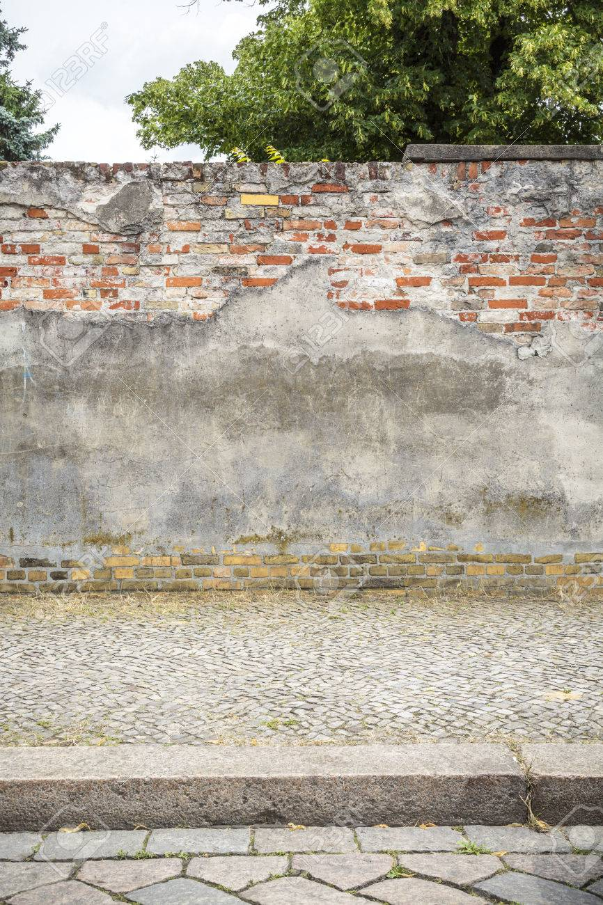 Old Plastered Red Brick Wall With Pavement, Cobblestone Road And Tree Stock  Photo   29731377