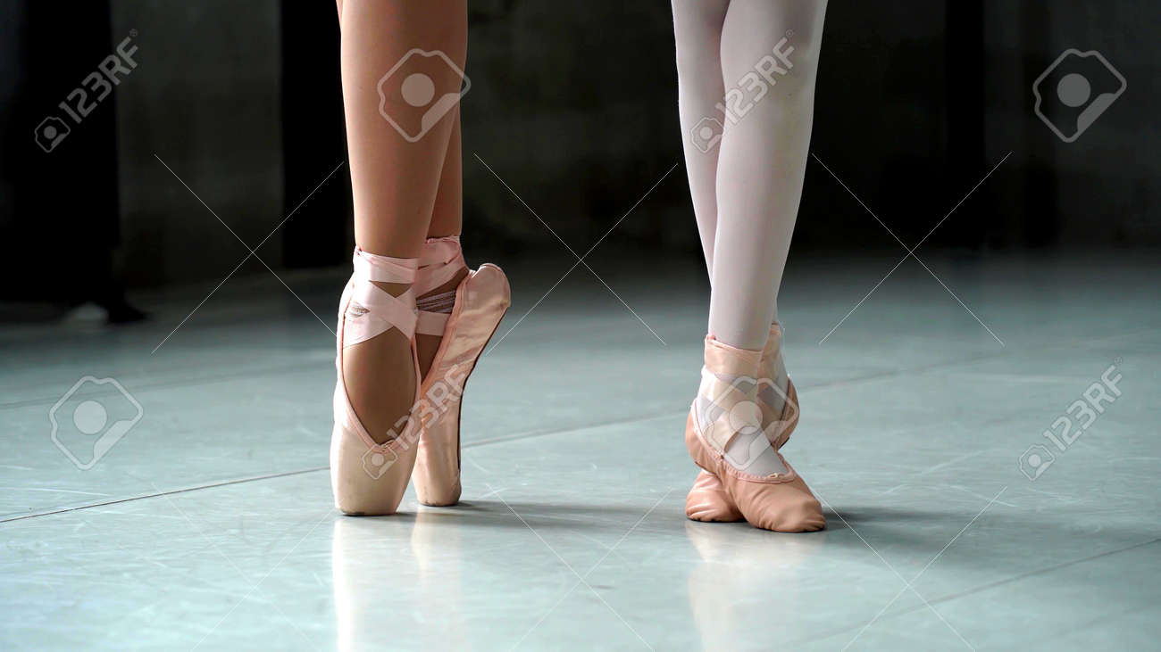 A close up on a ballerina feet during a ballet with focus - 154572052