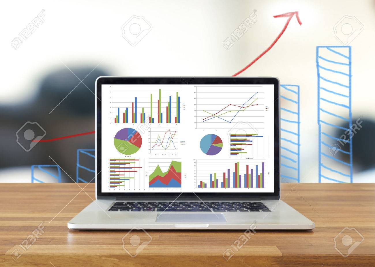 Laptop on wooden table showing charts and graph analysis business imagens laptop on wooden table showing charts and graph analysis business accounting statistics concept ccuart Image collections