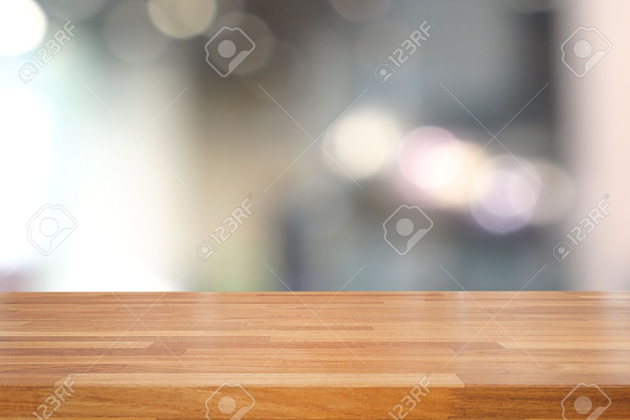 Plain wood table with hipster brick wall background stock photo - Background Brown Empty Wooden Table And Blurred Kitchen Background Product Montage Display