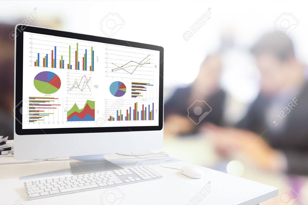 Modern computer with keyboard and mouse on table showing charts and graph against blurred business people background , Analysis Business, Statistics Concept. - 54568535