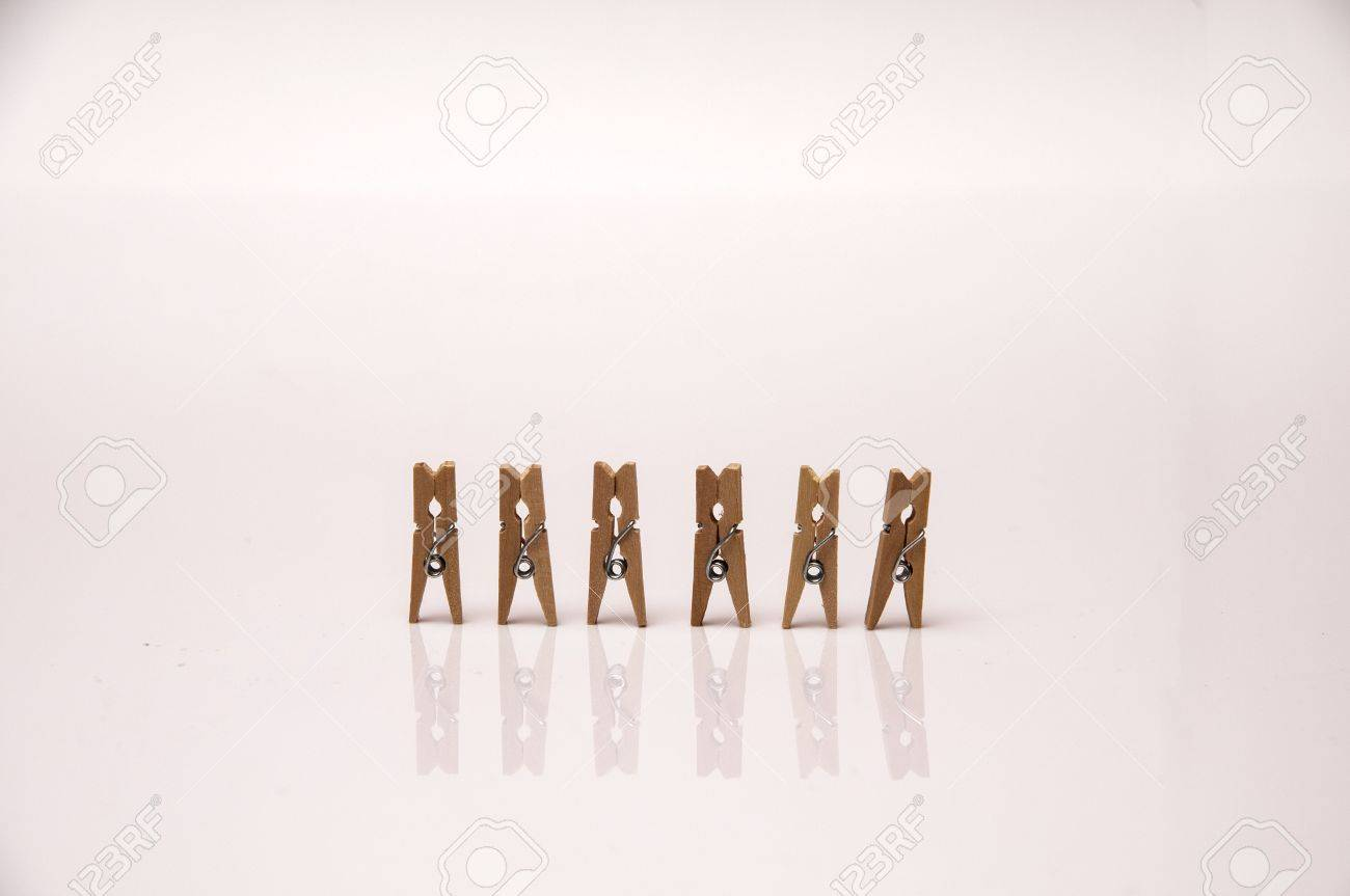 Small Wooden Clamps To Attach Several Sheets Of Paper Stock Photo