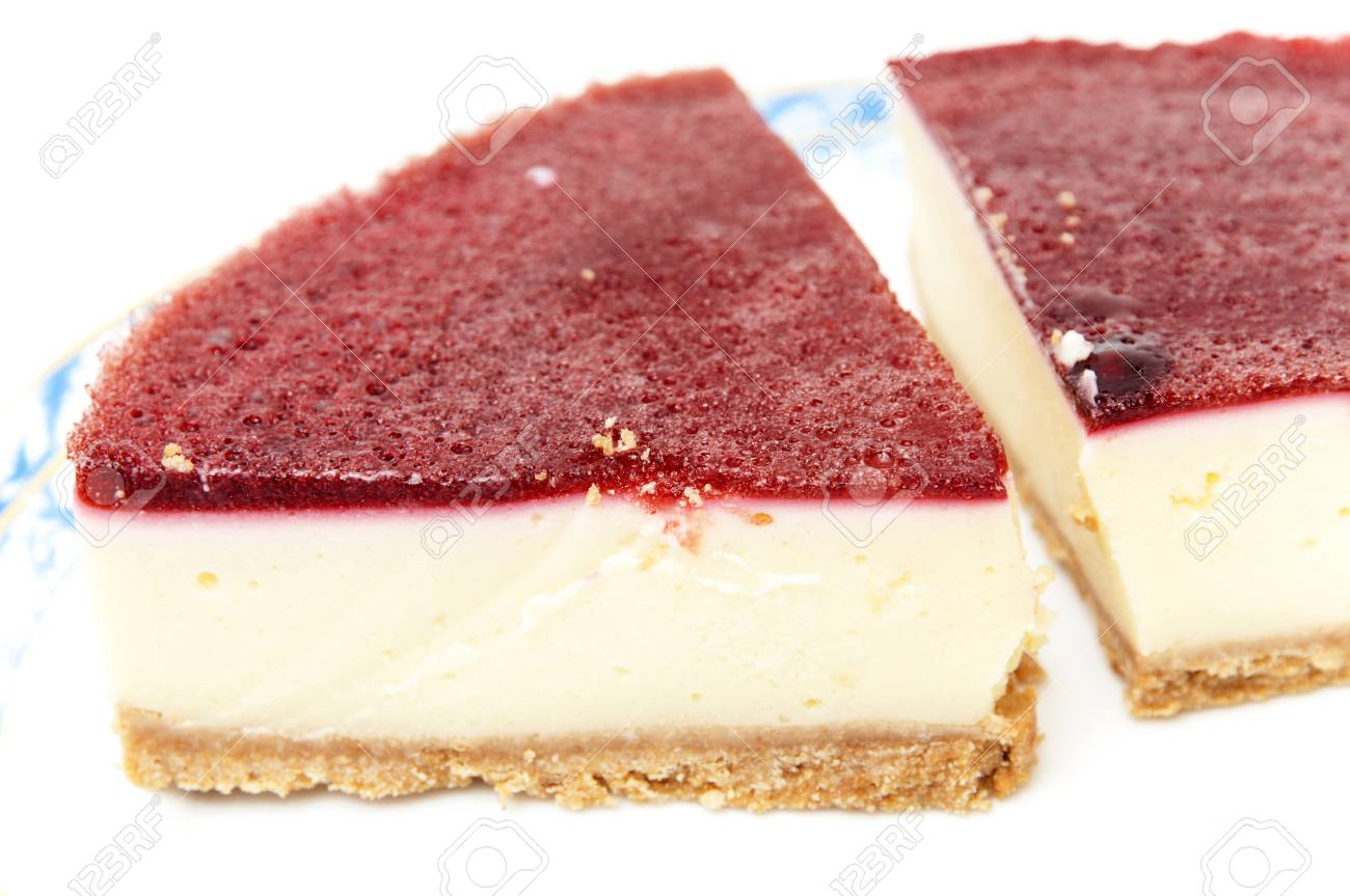 cheesecake with strawberry syrup on a white background Stock Photo - 22074848