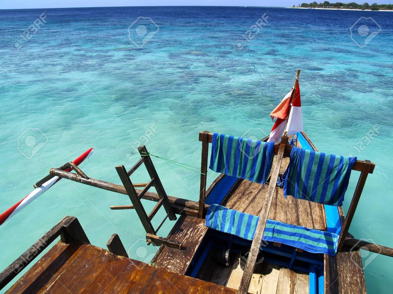 balinese boat on white sand beach - 130467065