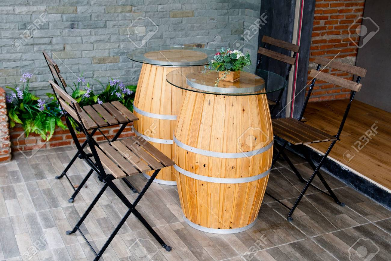 Chair And Oak Barrel Table In Restaurant Stock Photo   47274306