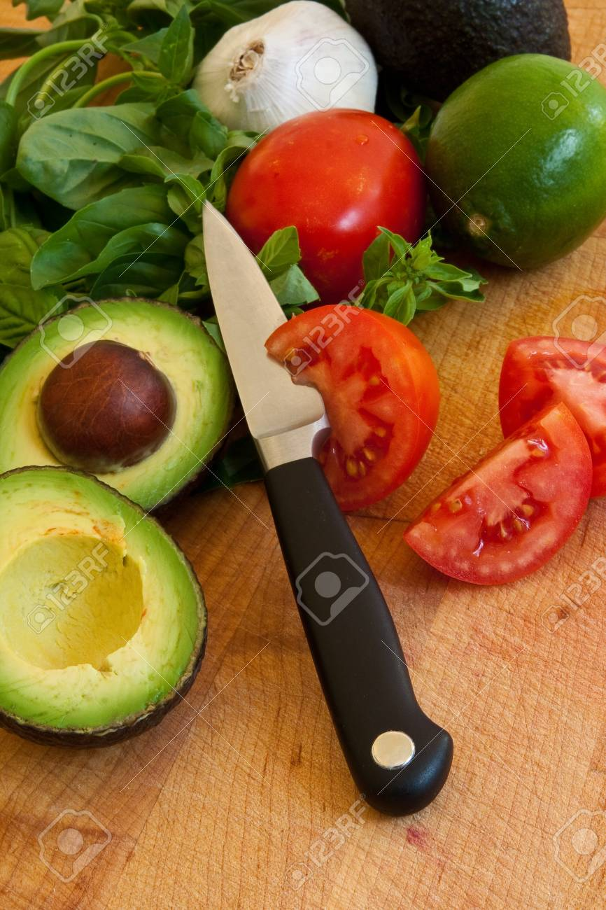 Mixed vegetables avocados, tomatoes, and basil Stock Photo - 7485497