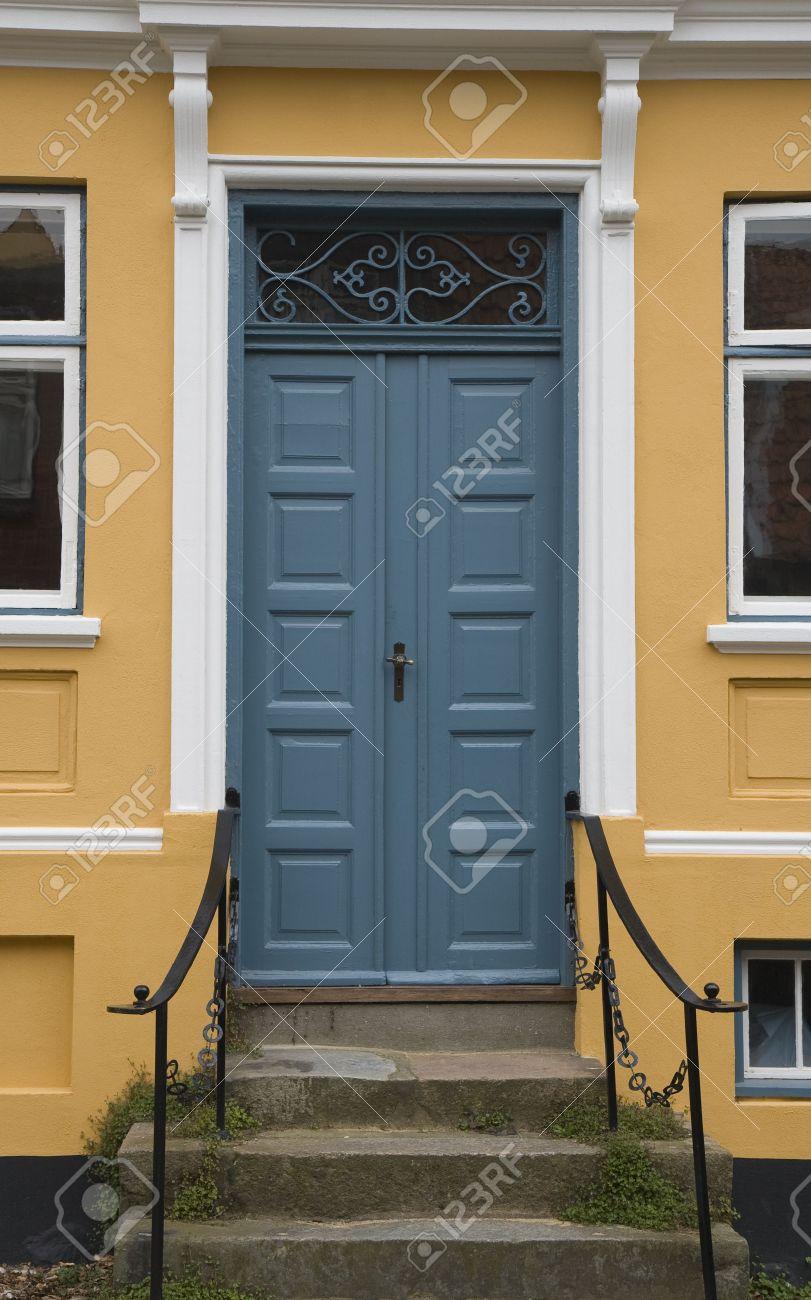 blue door house. Blue Door In A Yellow House At Viborg, Denmark Stock Photo - 4062344