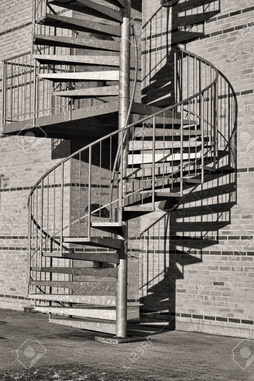 Black And White Shot Of A Winding Staircase Stock Photo   81072319
