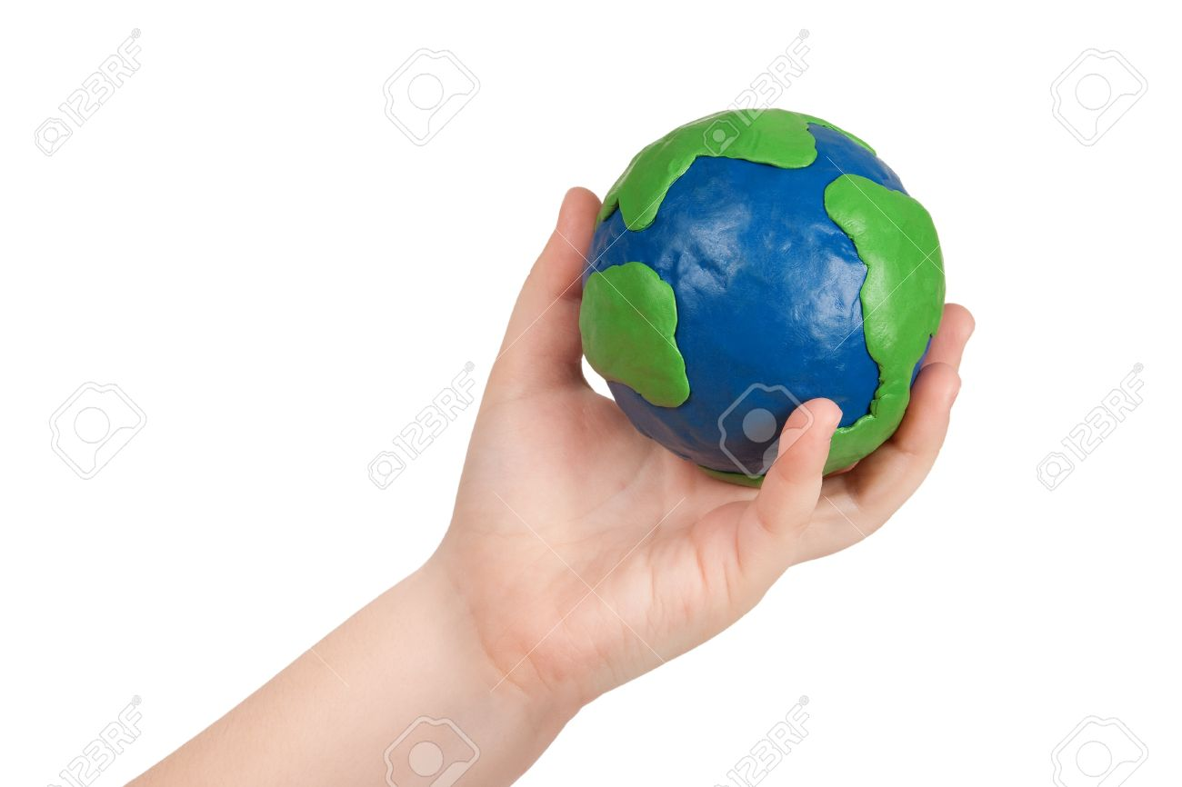 Child's hand holding a plasticine model of the globe of the earth Stock Photo - 9113201