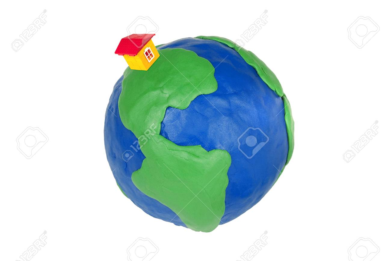 Plasticine globe and toy house on a white background Stock Photo - 9664087