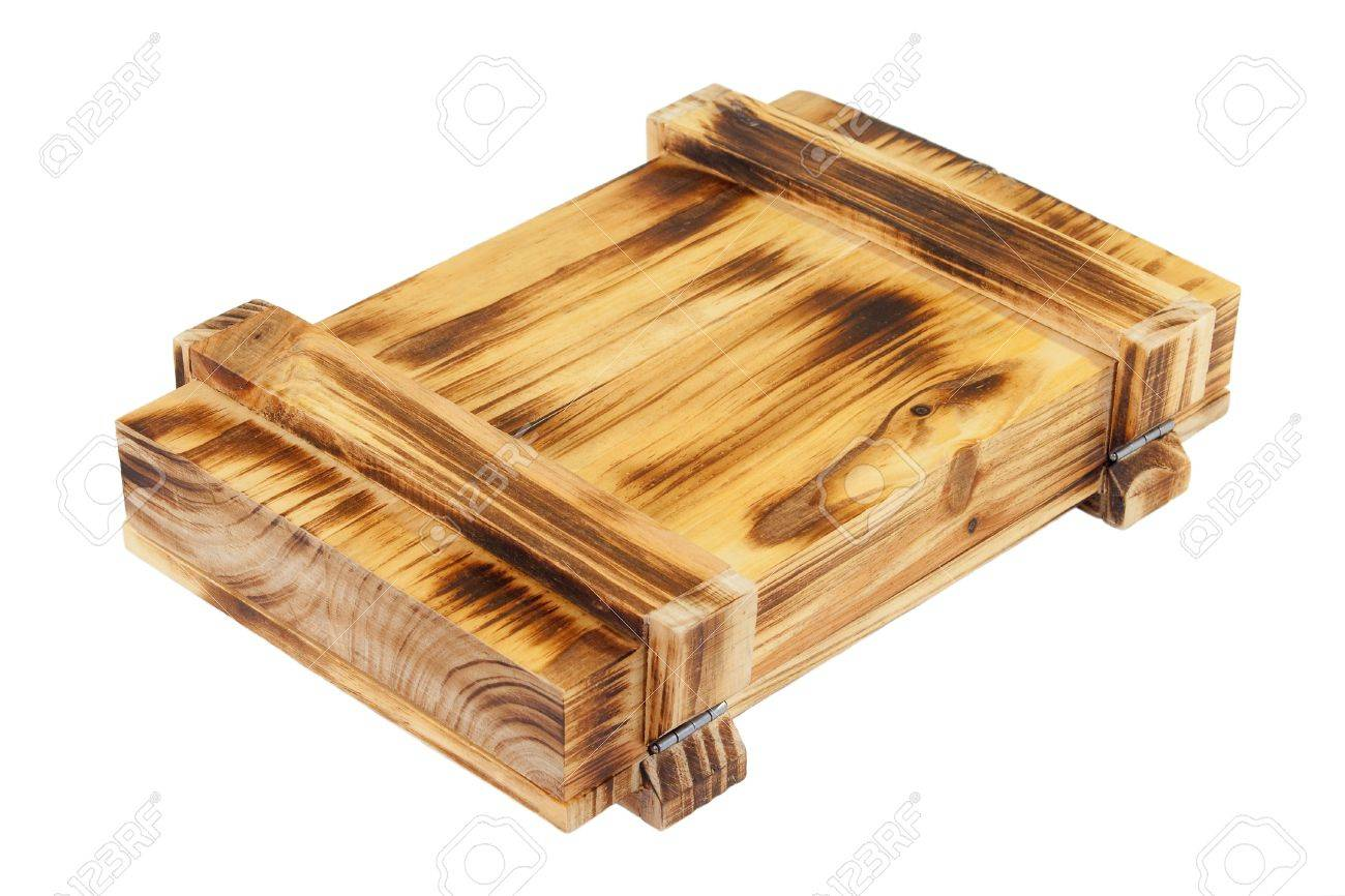 Decorative wooden box with metal hinges on a white background Stock Photo - 12872969