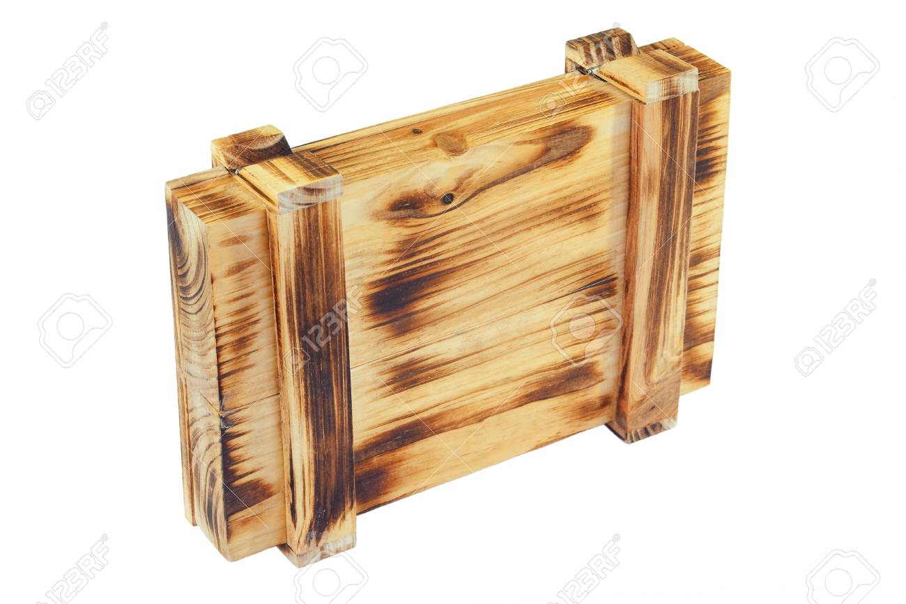 Decorative wooden box with metal hinges on a white background Stock Photo - 12873005