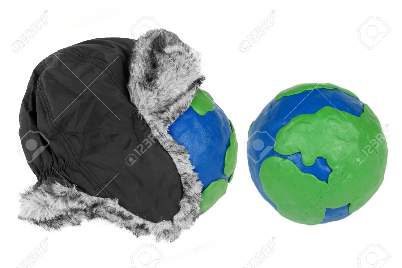 Winter hat with fur and two plasticine Hemisphere land Stock Photo - 16964473