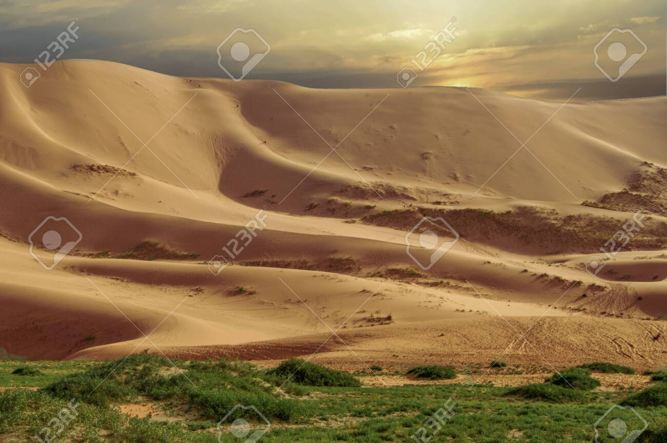 Mongolian Desert Sand Dunes of Close To 350 sq. Miles. This area is great for climbing the dunes to see what is on the other side. - 128428045