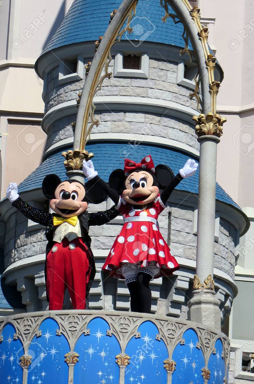 Mickey and Minnie at Cinderella Castle on Magic Kingdom in the day on February 11, 2015 in Orlando - Florida - 37609420