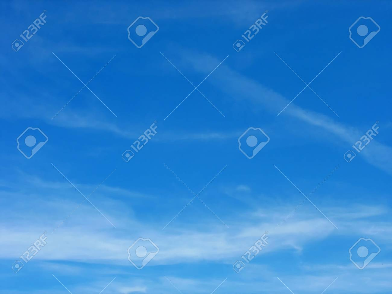 Blue sky and white high cirrus fluffy clouds Stock Photo - 5083795