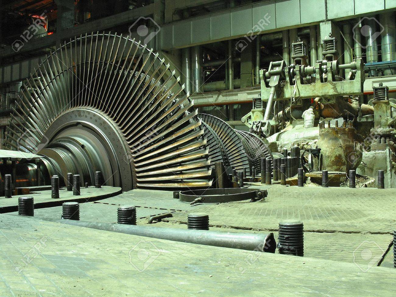Power generator steam turbine during repair, machinery, pipes, tubes at a power plant, night scene Stock Photo - 8913353