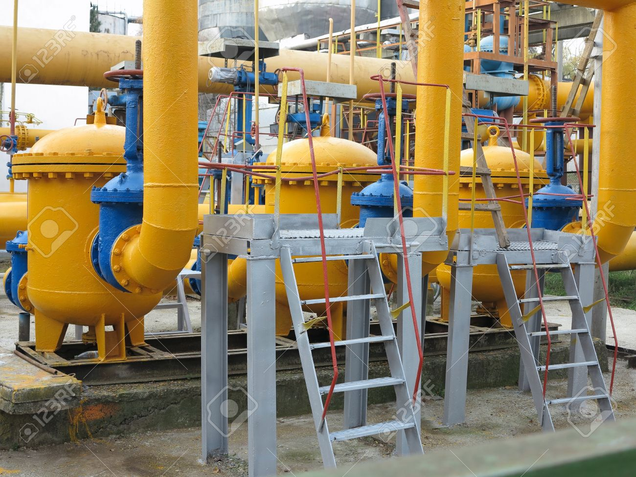 Natural gas station with yellow pipes at power plant Stock Photo - 17364855