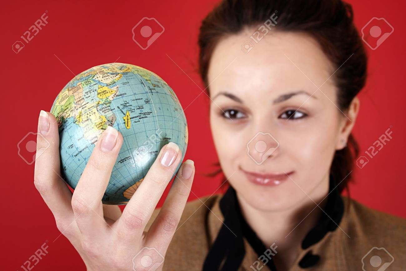 Globe in a girl's hands. Isolated on red Stock Photo - 5371875