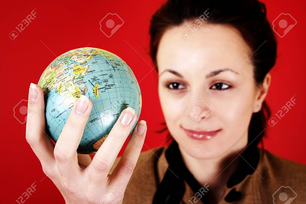 Globe in a girl's hands. Isolated on red Stock Photo - 12467048