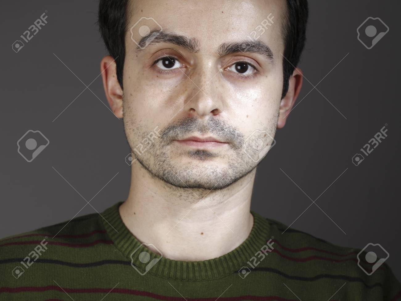 Portrait of a young man, isolated on background Stock Photo - 17605743