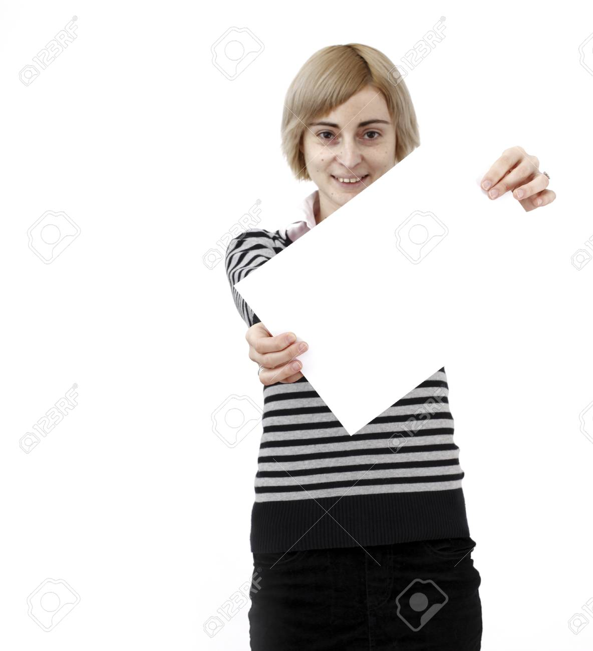 Young blonde woman holding a blank piece of paper. Stock Photo - 21305148