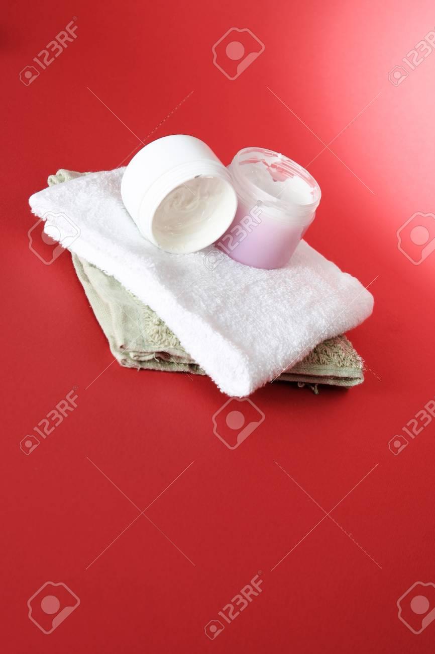 Moisturizing cream on red background Stock Photo - 23791590
