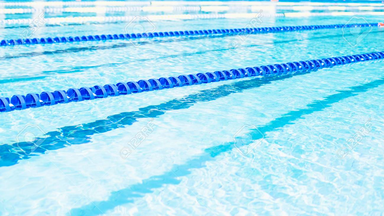 Swimming lanes with clear blue water in public swimming pool in summer Stock Photo - 61653338