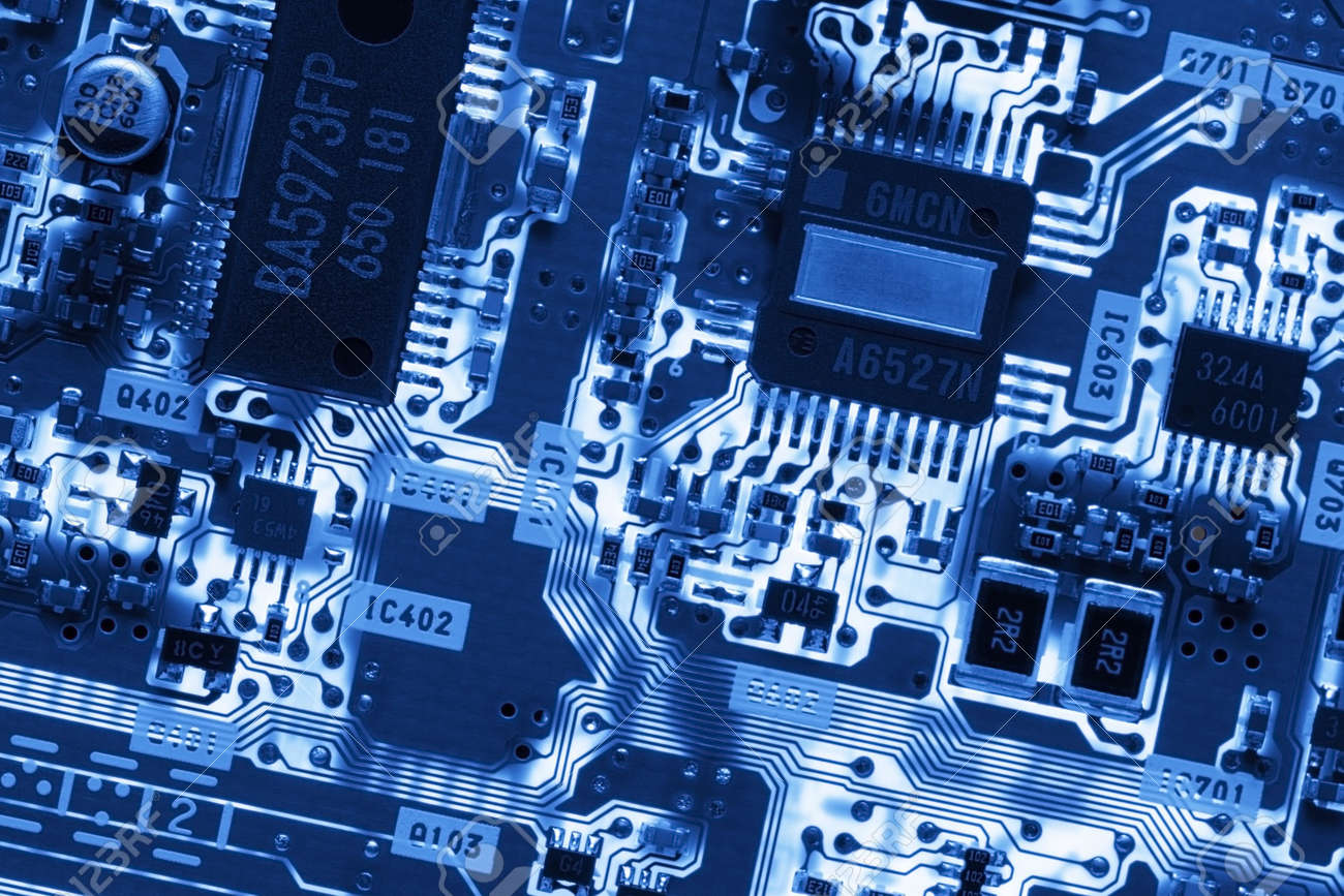 Blue Glowing Circuit Board. Close-up Detail Of A Computer Circuit ...