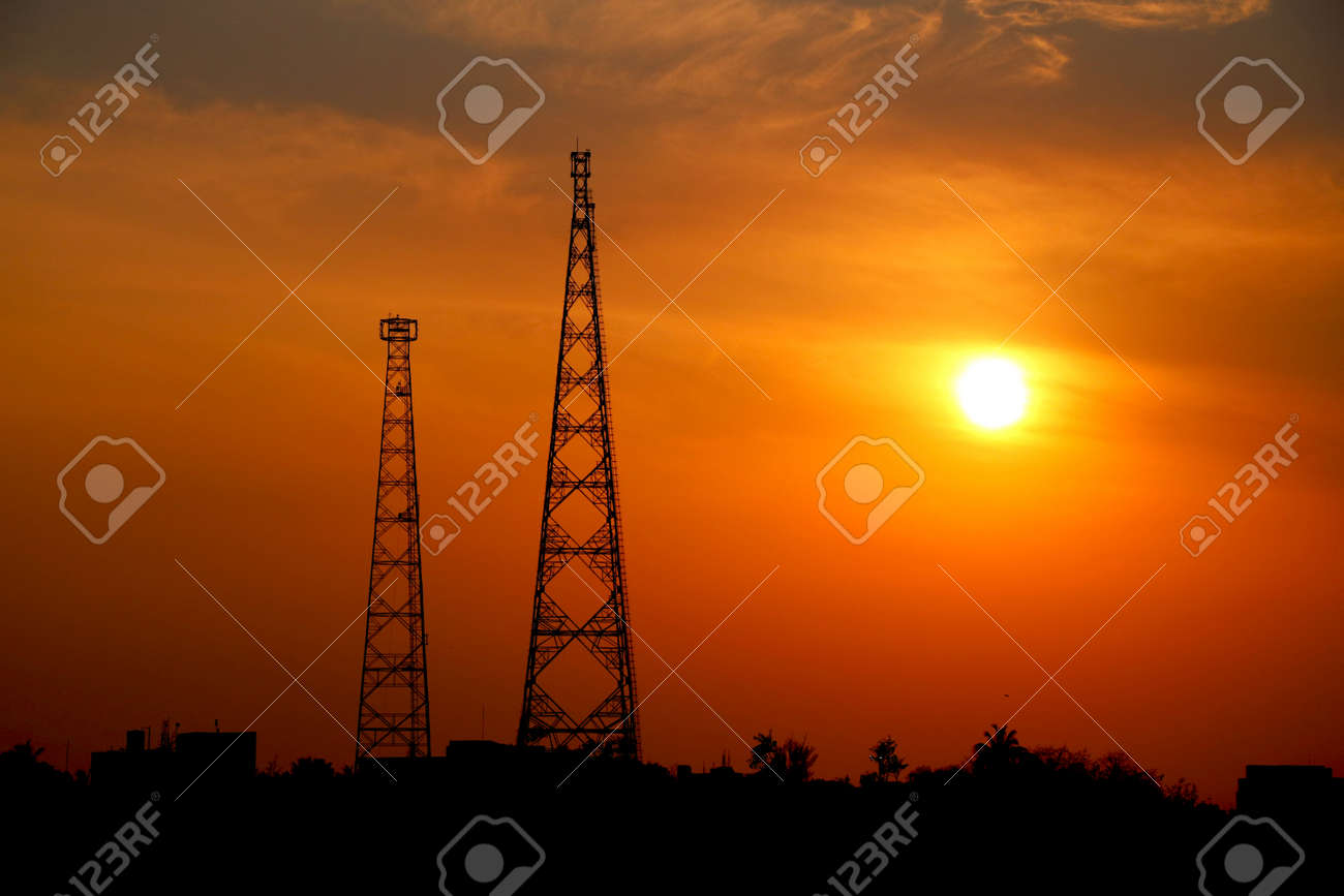 sunset view with two telecommunication tower - 157737982