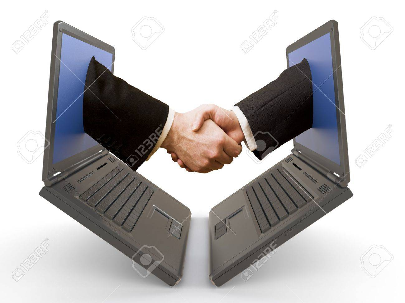 handshake emerging from two laptop&acute,s screens. Stock Photo - 4356324