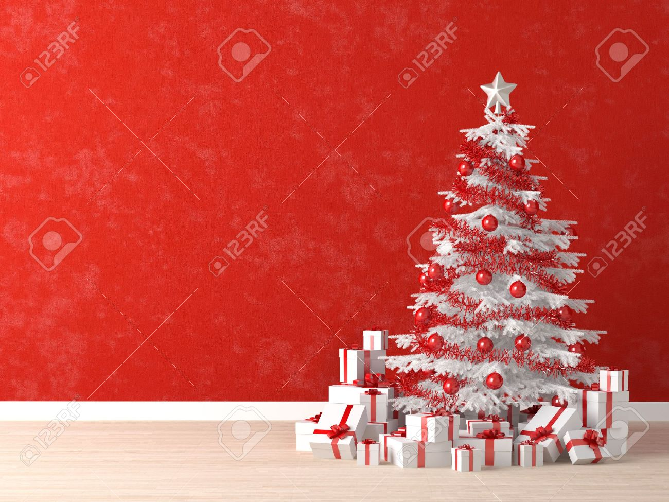 White christmas tree with red decorations - Stock Photo White And Red Christmas Tree Decorated With Many Presents On A Vibrant Red Wall For Background Copy Space At Left