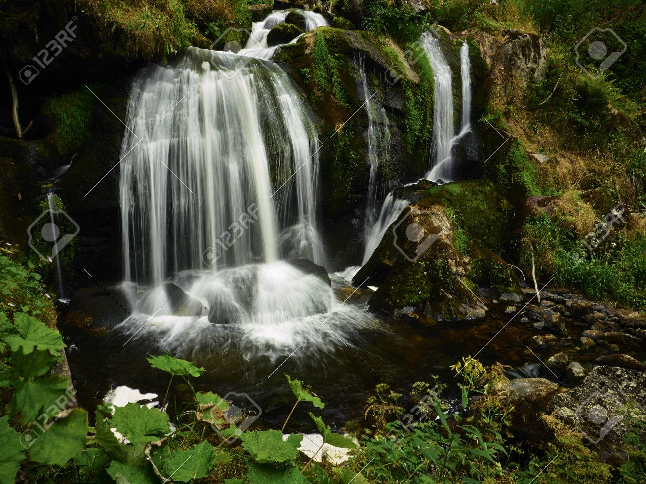 Beautiful Scenery Of Waterfall On A Hot Summer Day Stock Photo