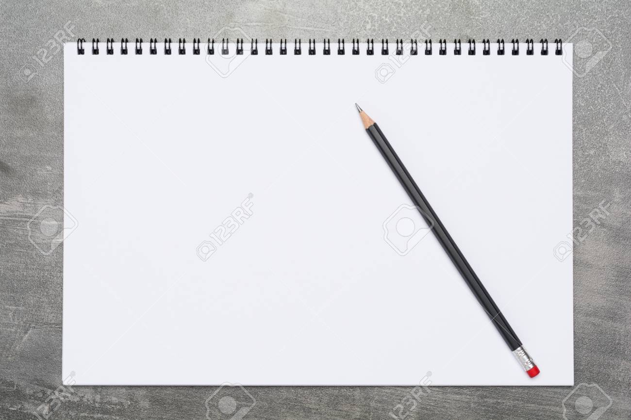 Blank page of a sketchbook with a black pencil on a grunge gray