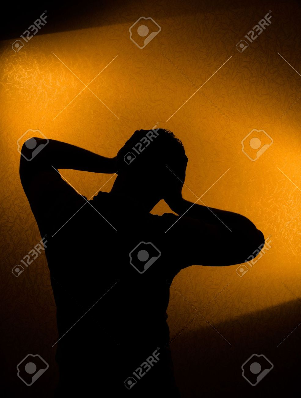 Depression and pain - silhouette of man in the darkness Stock Photo - 6546693