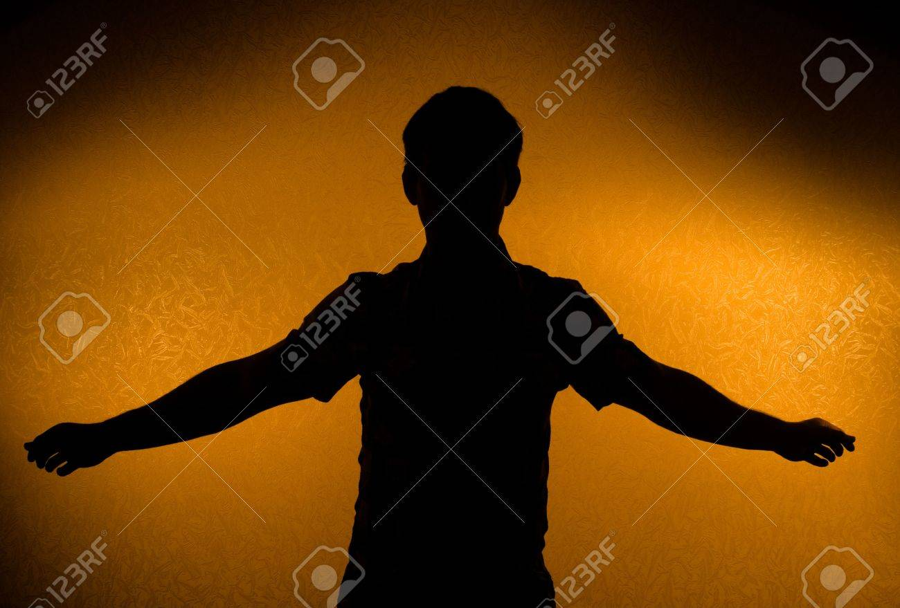 Breakthrough - male silhouette with opened arms (back light) Stock Photo - 6813773