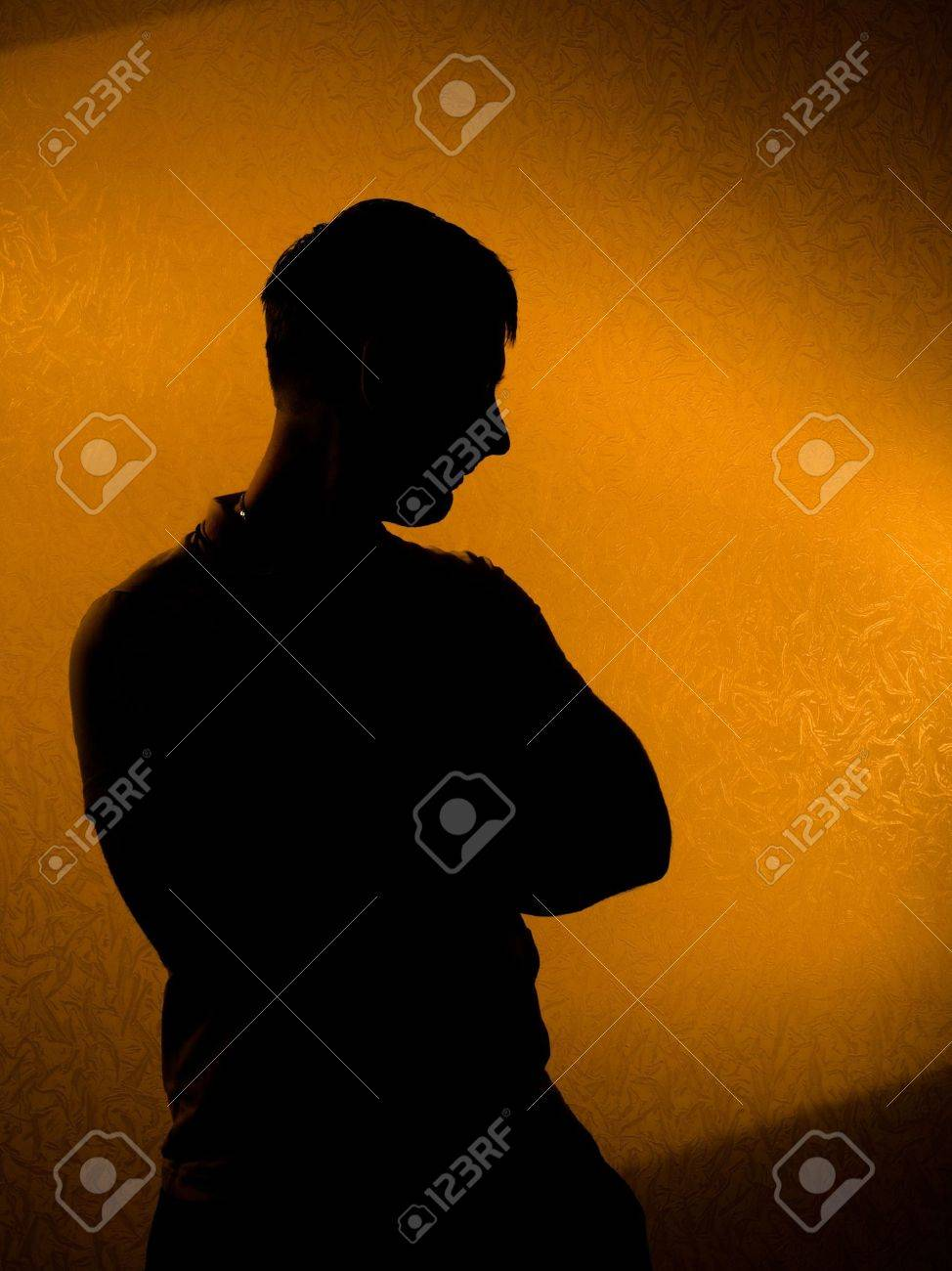 Thinking of something. silhouette of man in the darkness Stock Photo - 6835805