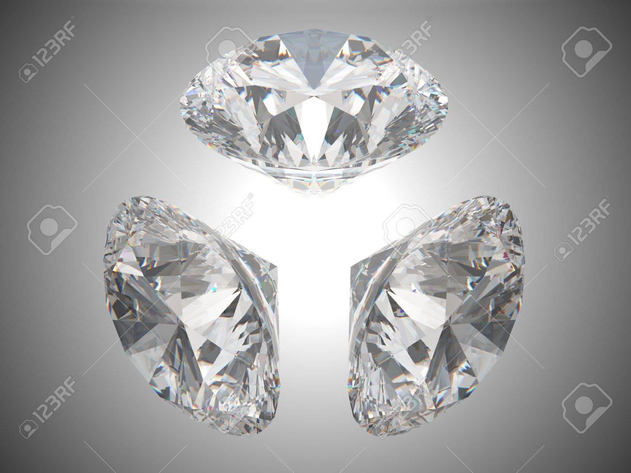 Three brilliant cut diamonds or gems. Over grey background Stock Photo - 8183448