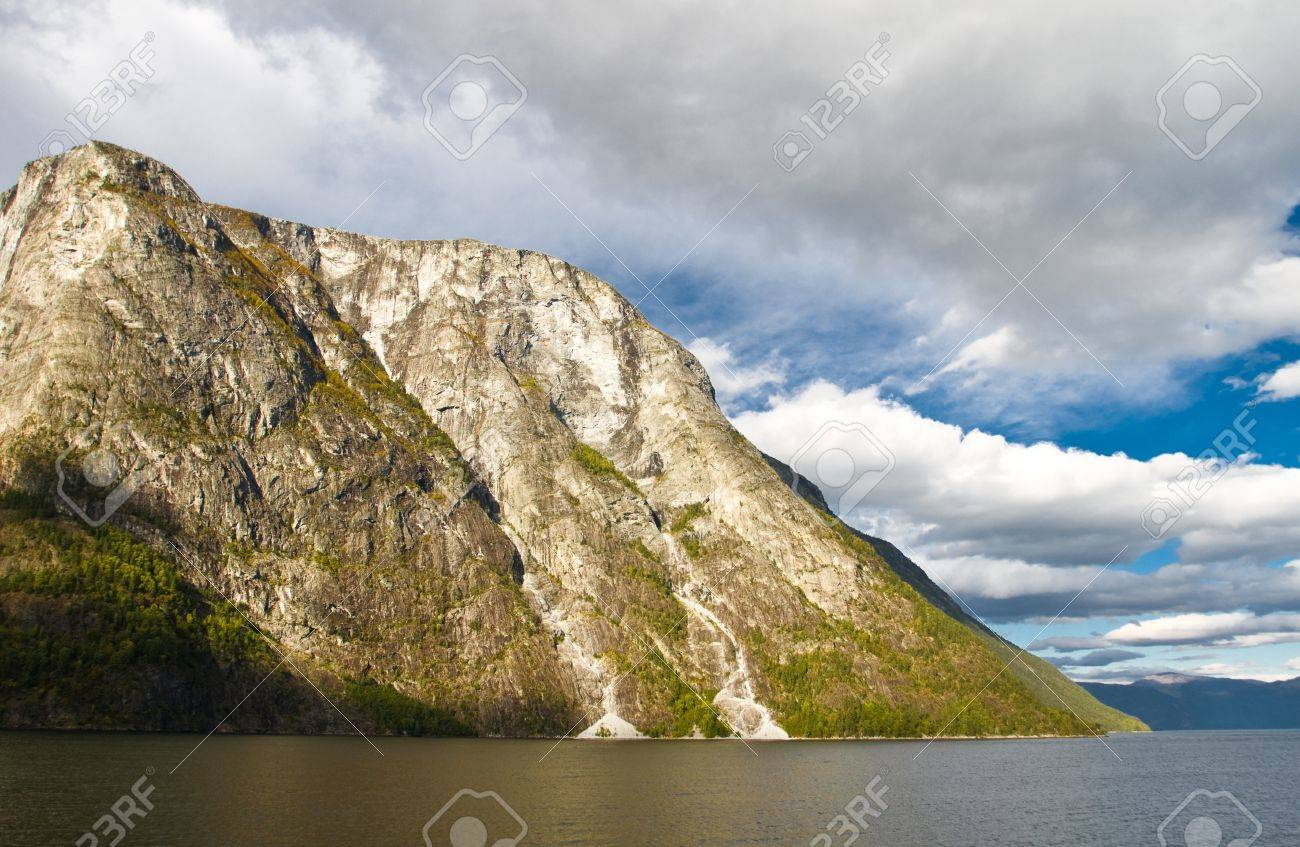 Mountains and fjord in Norway. Cloudy sky Stock Photo - 8295670