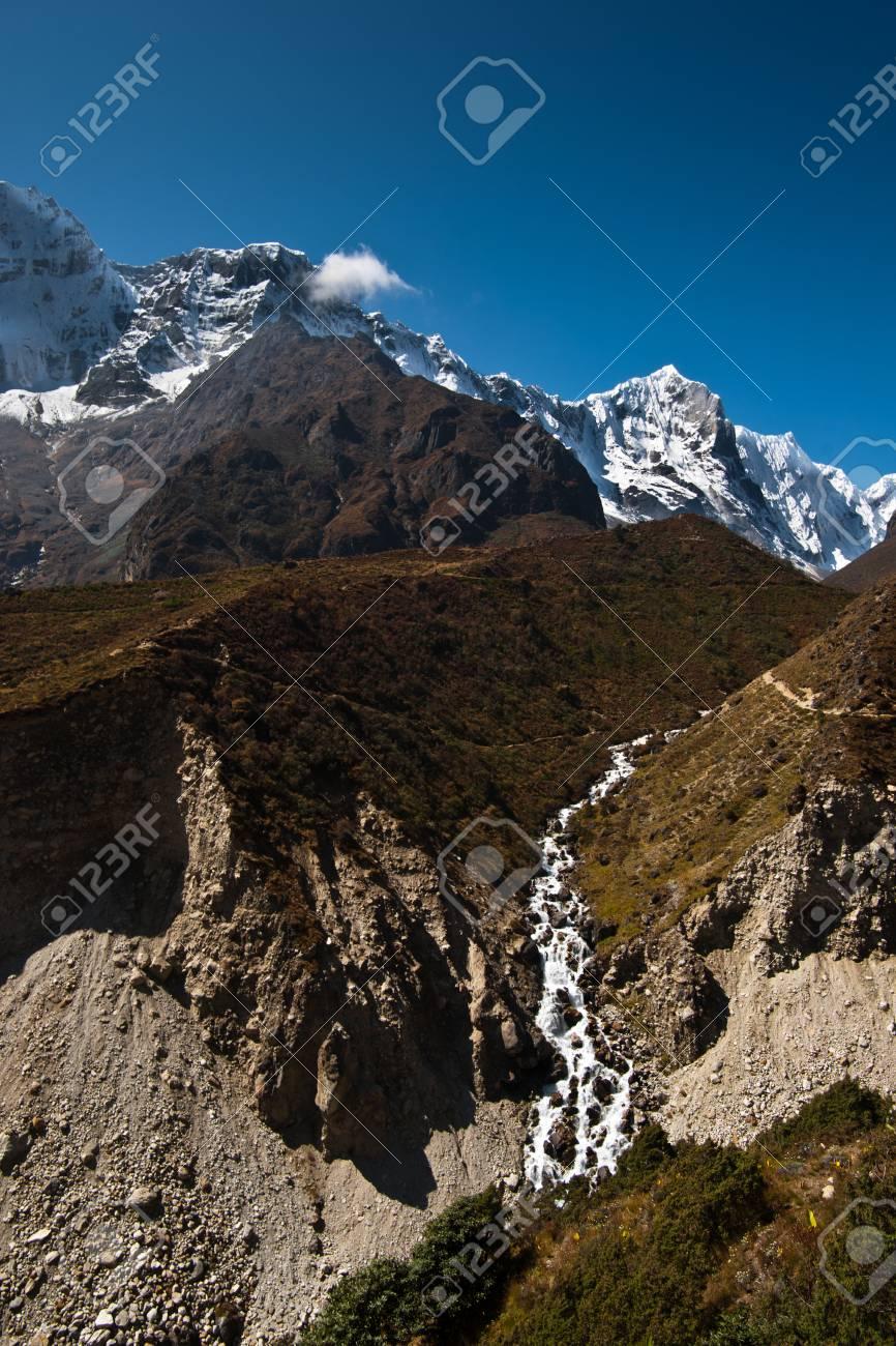 Himalaya landscape: stream and snowed peaks. Captured in Sagarmatha National park Stock Photo - 12901808
