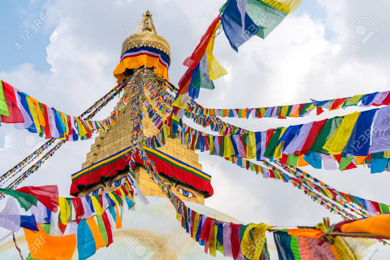 Boudhanath Stupa and prayer flags in Kathmandu, Nepal. Buddhist stupa of Boudha Stupa is one of the largest stupas in the world - 107684725