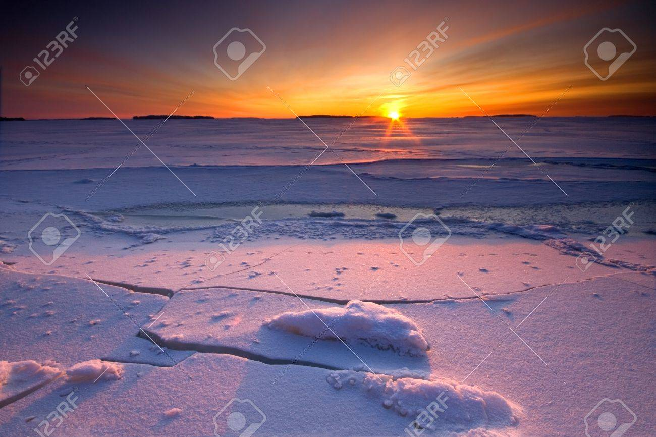 Sunrise over frozen and snowy coast of Finland Stock Photo - 16914813